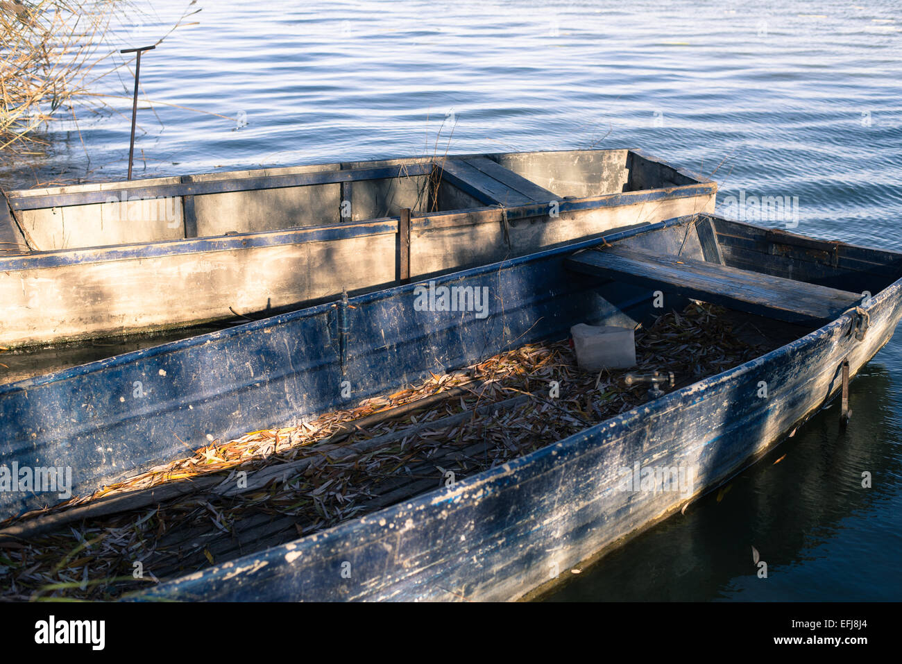 Two boats at moorage on a lake - Stock Image