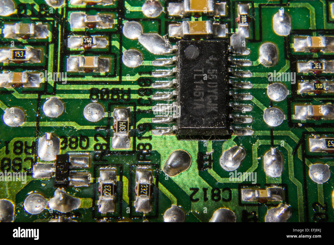 Closeup of a computer chip on a printed circuit board. - Stock Image