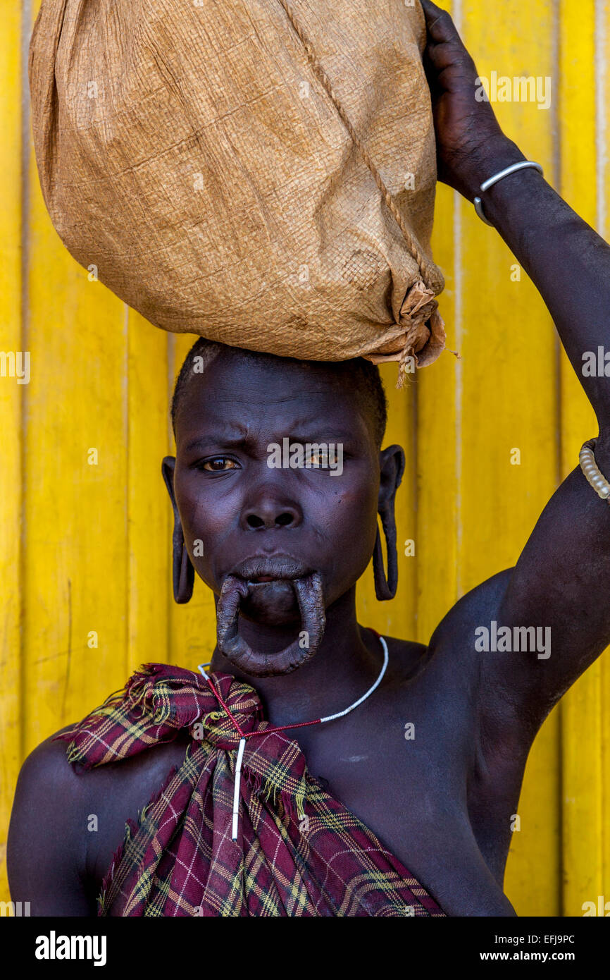 Portrait Of A Woman From The Mursi Tribe, Jinka Town, Omo Valley, Ethiopia - Stock Image