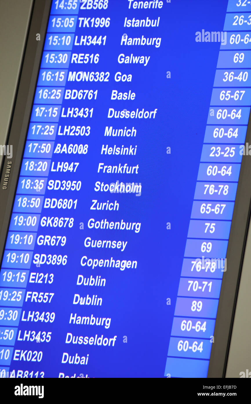 Destination board for aeroplane flights at Manchester Airport - Stock Image