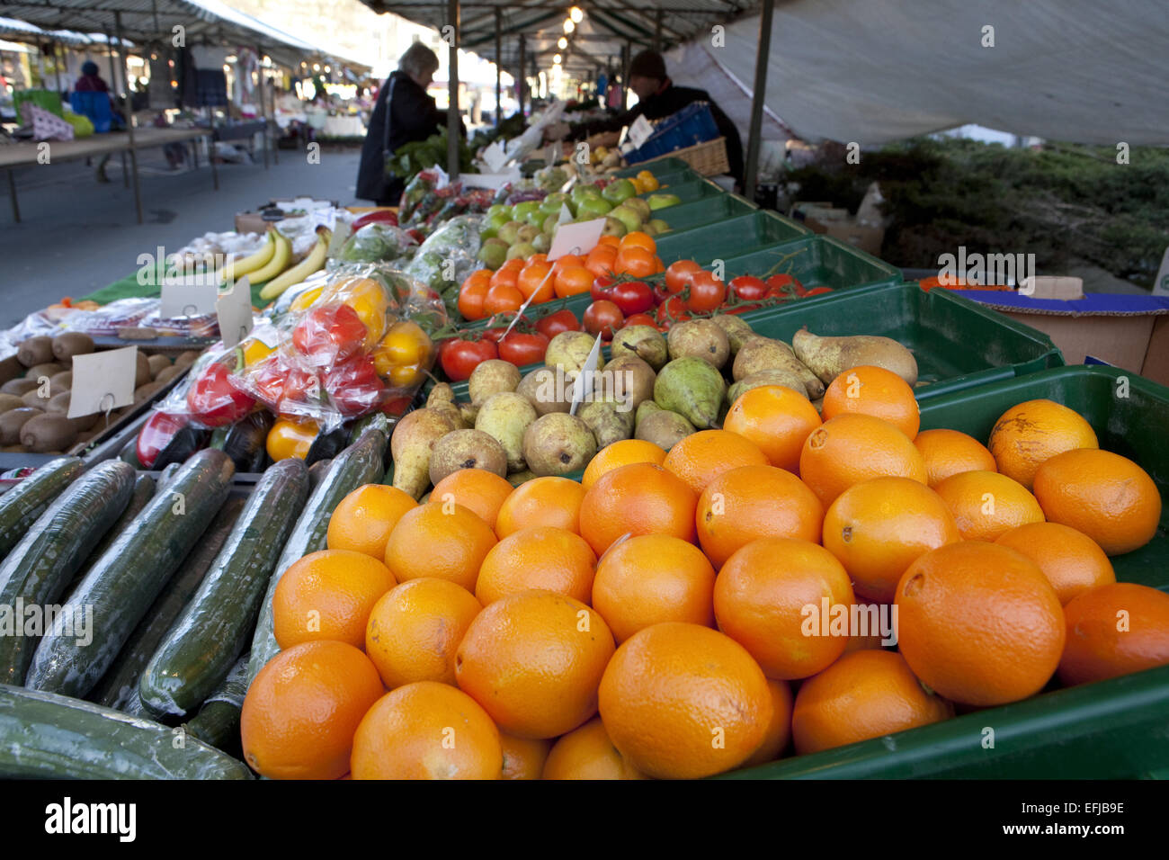 Fruit and vegetable market stall with oranges - Stock Image