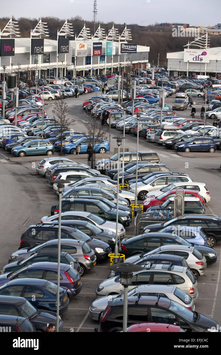 Cars in car park at retail park - Stock Image