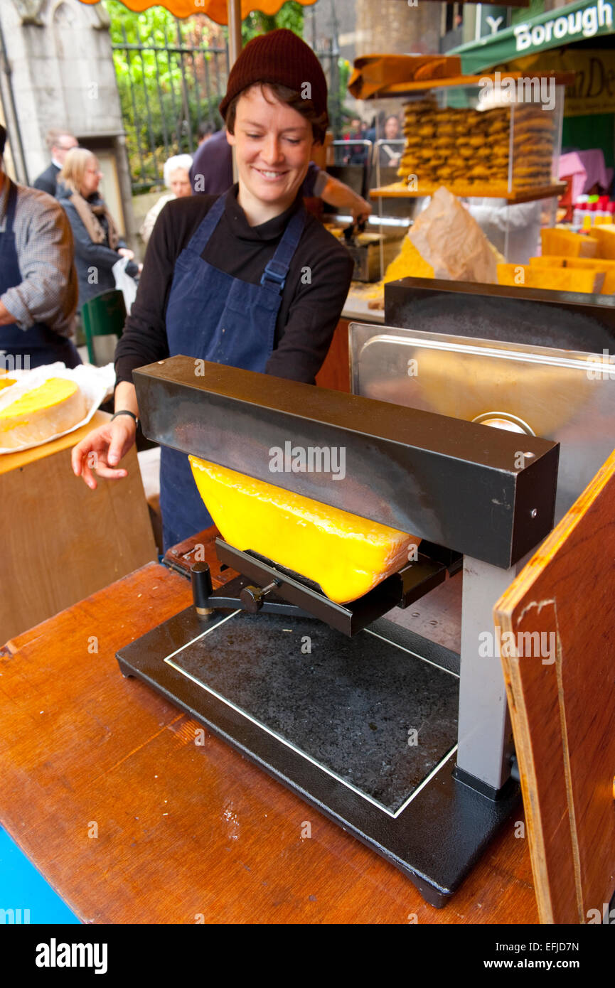 Raclette chese being cooked at Borough Market. Borough Market is a wholesale and retail food market in Southwark, - Stock Image