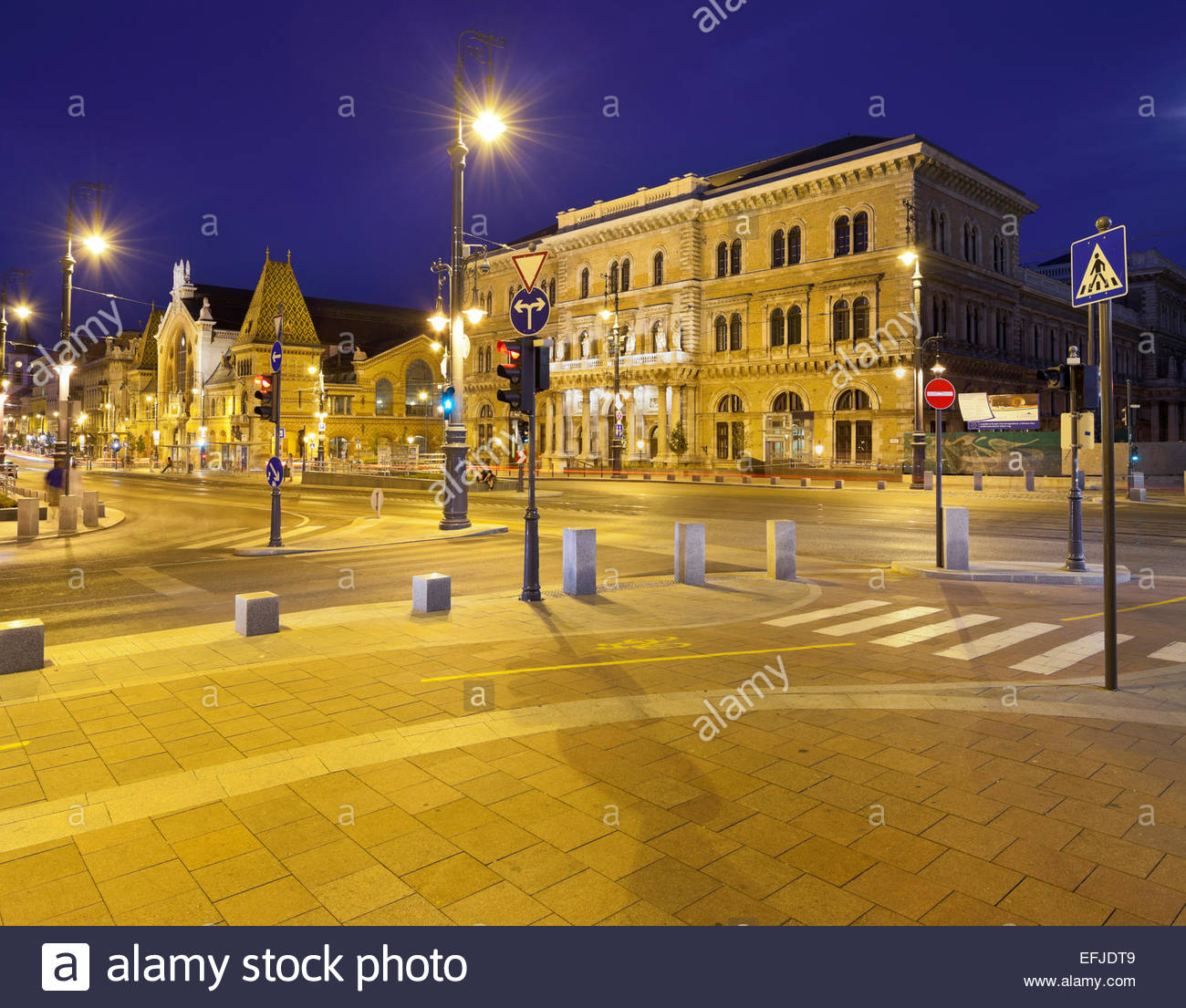 Corvinus University and the markethall at night, Unesco World Cultural Heritage Site, Budapest, Hungary - Stock Image
