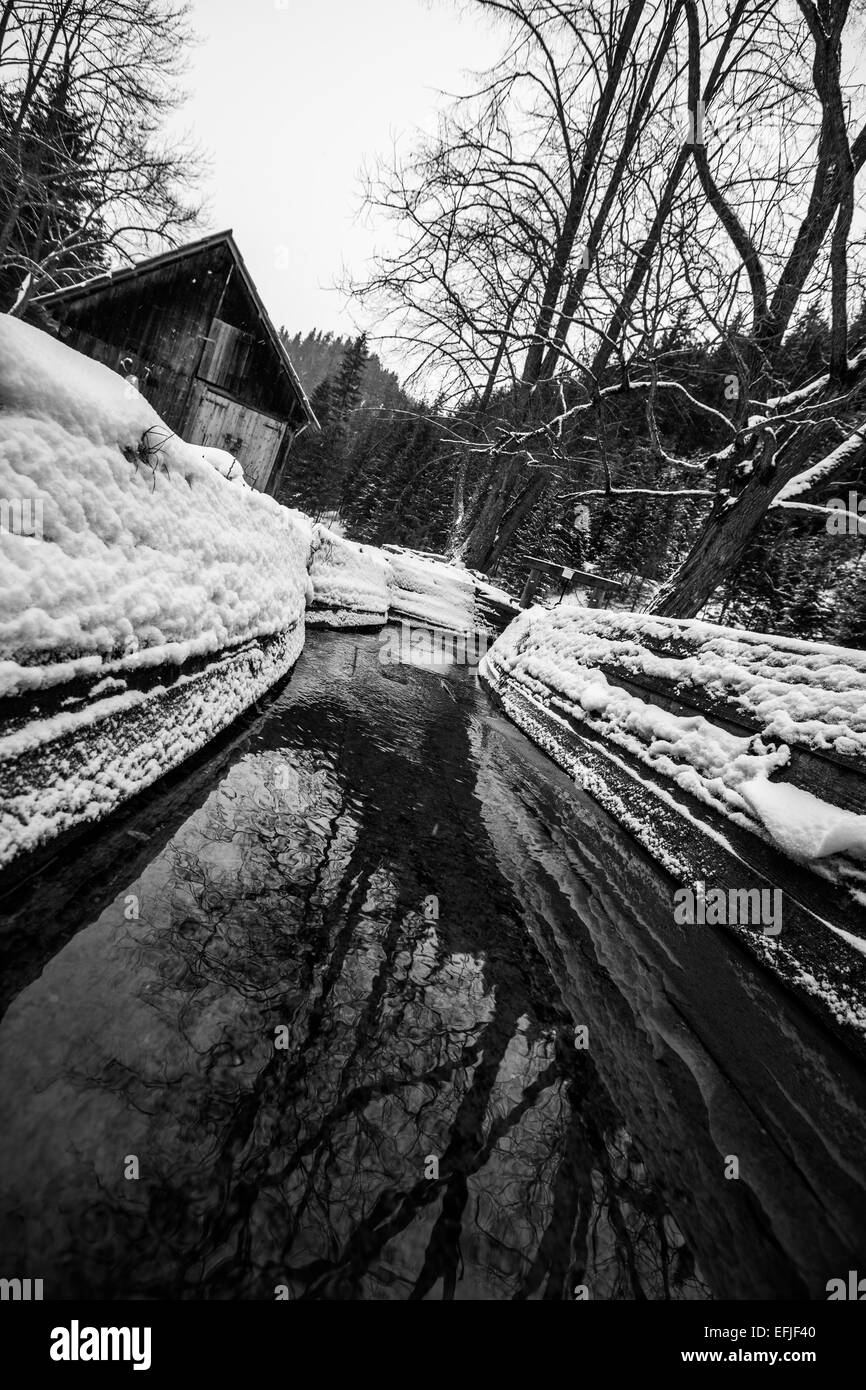 canal that was mill in the past but now it is covered in snow - Stock Image