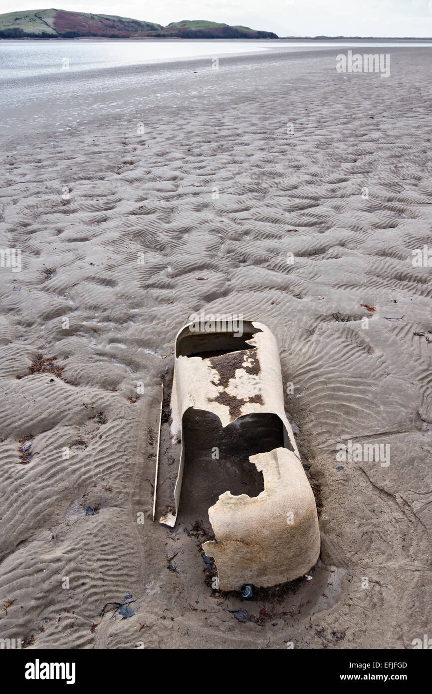 Old fibreglass bath washed up on a beach, North Wales, UK Stock ...