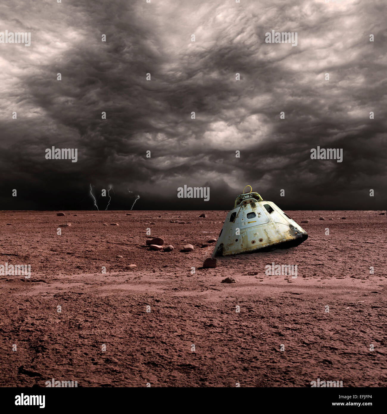 A scorched space capsule lies abandoned on a barren world. Storm clouds and lightning are in the background. - Stock Image