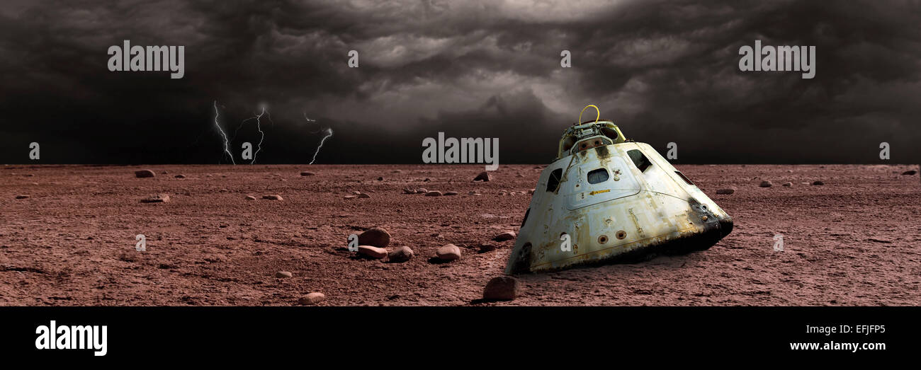 A scorched space capsule lies abandoned on a barren world. Storm clouds and lightning are the background of a failed - Stock Image