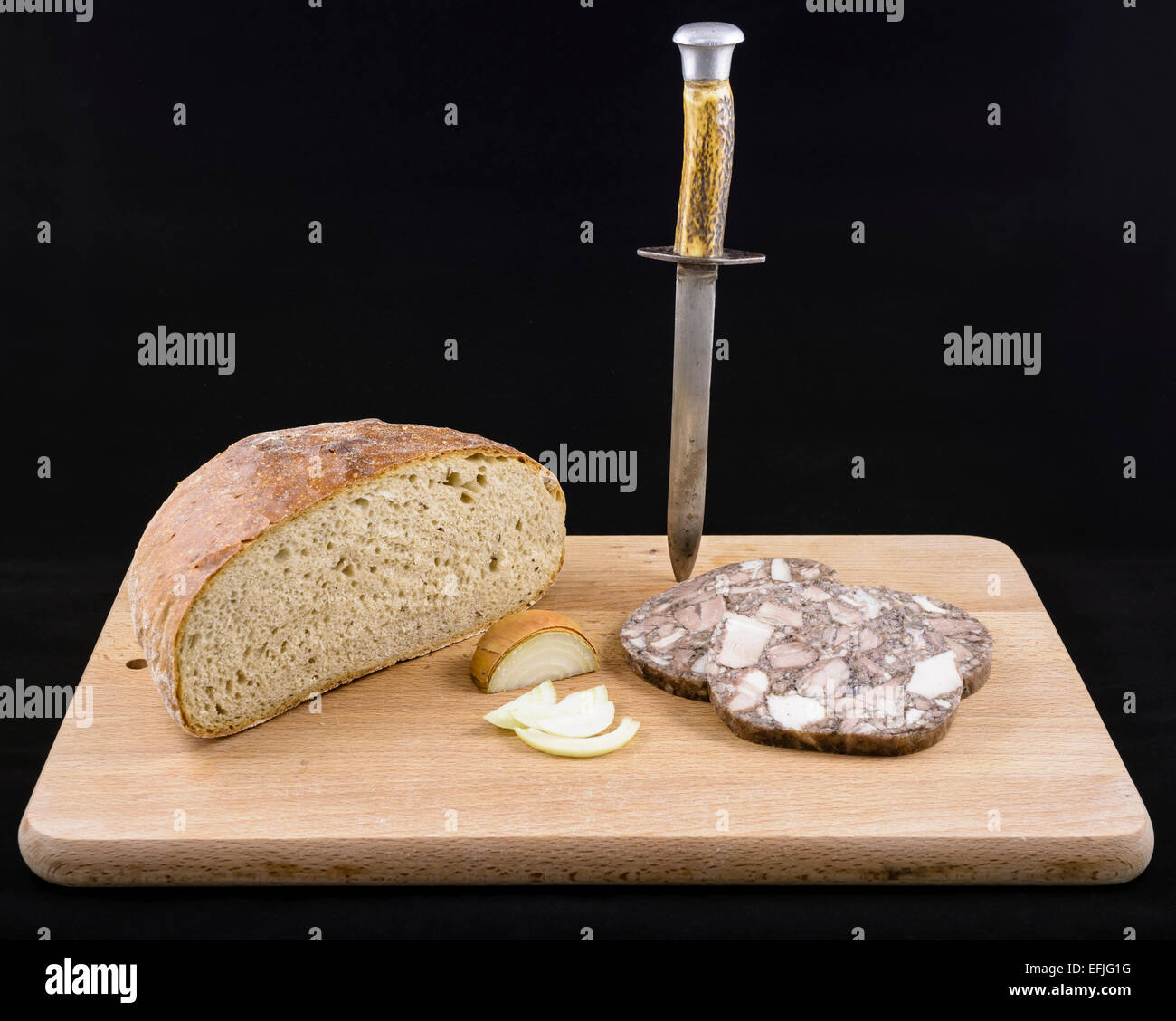 Retro pork brawn, rye bread and onion food menu with vintage dagger and on black velvet background - Stock Image