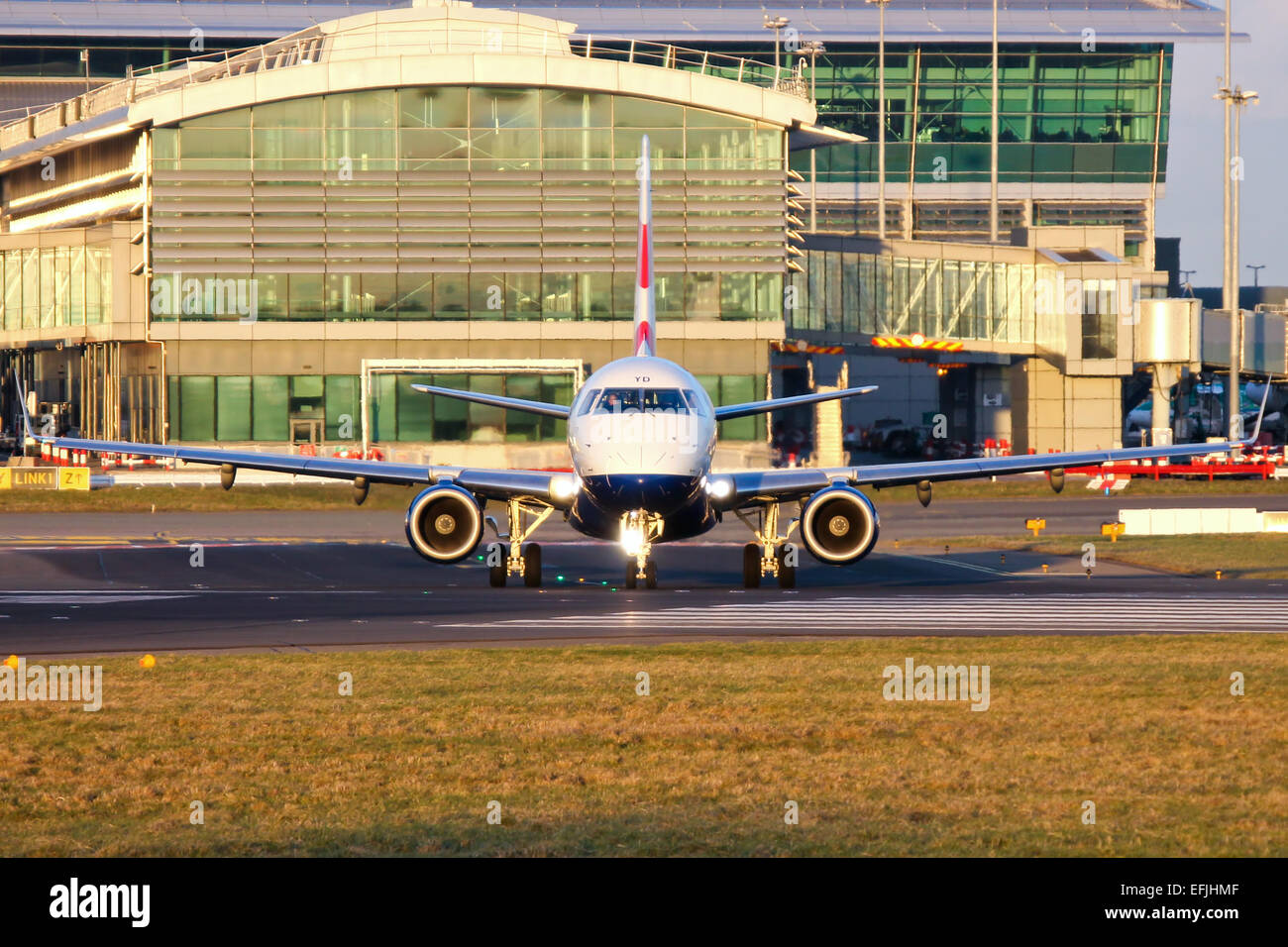 British Airways Embraer 170 lines up on runway 28 at Dublin airport. - Stock Image
