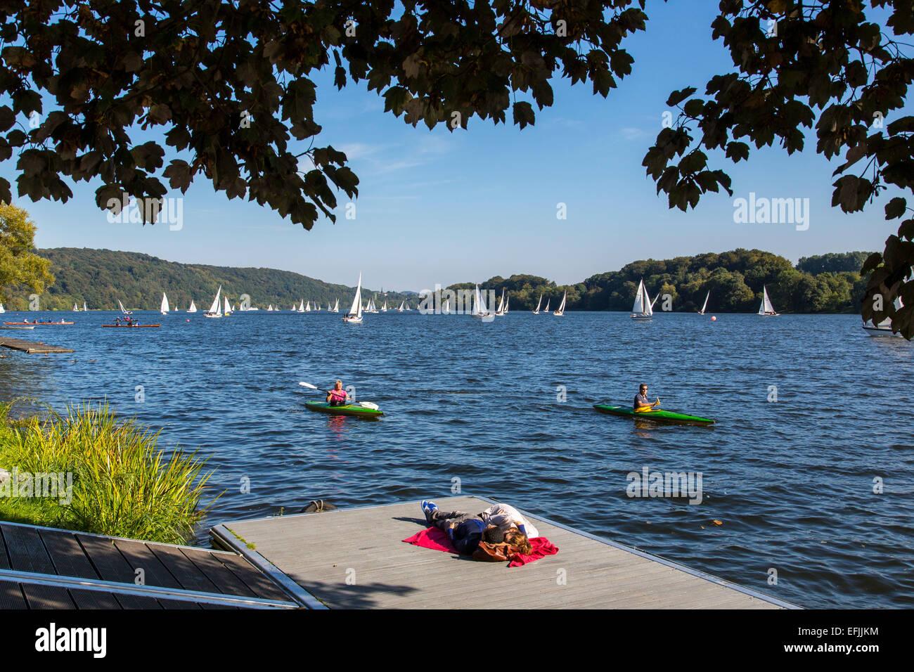 People enjoying summer, on a jetty, 'Baldeneysee' lake, river Ruhr, Essen, Germany, - Stock Image