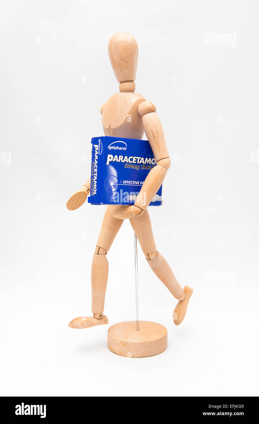 An artist's dummy holding a packet of paracetamol - Stock Image