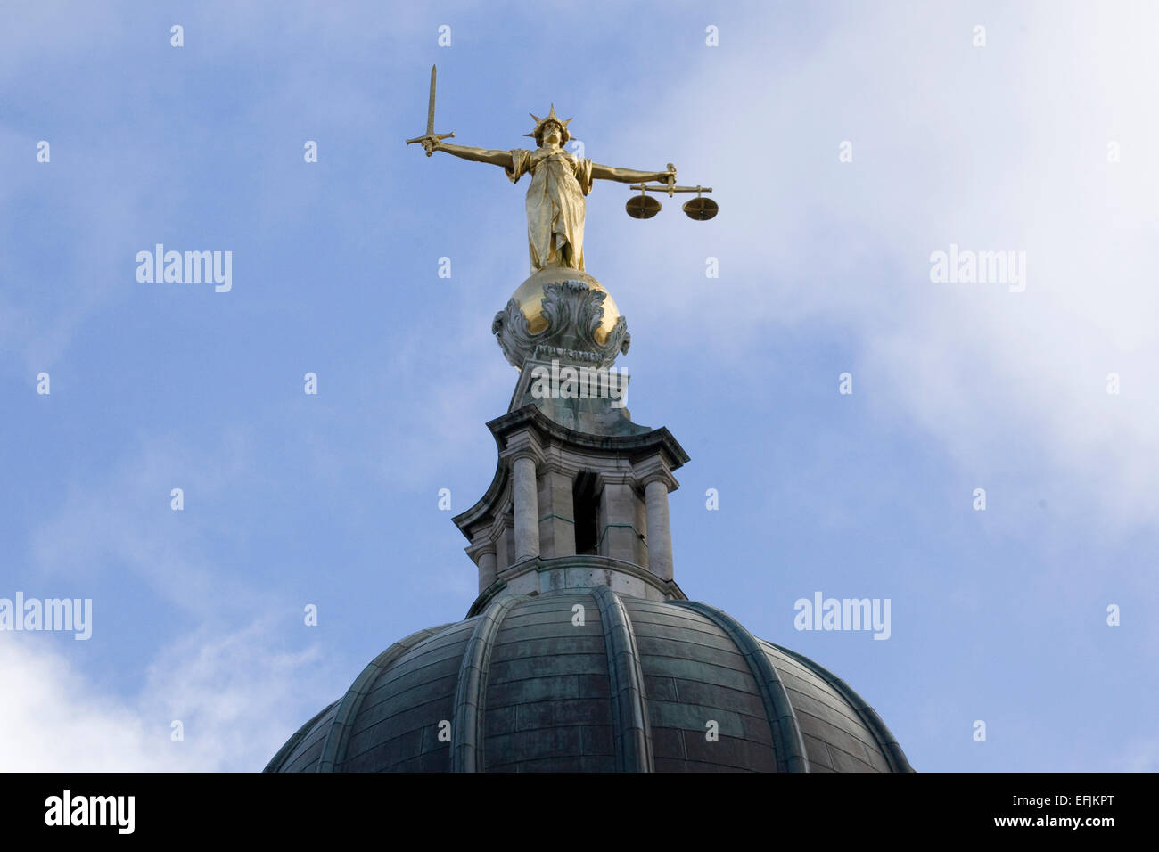Gold statue of Lady Justice statue on the top of the Old Bailey London England - Stock Image
