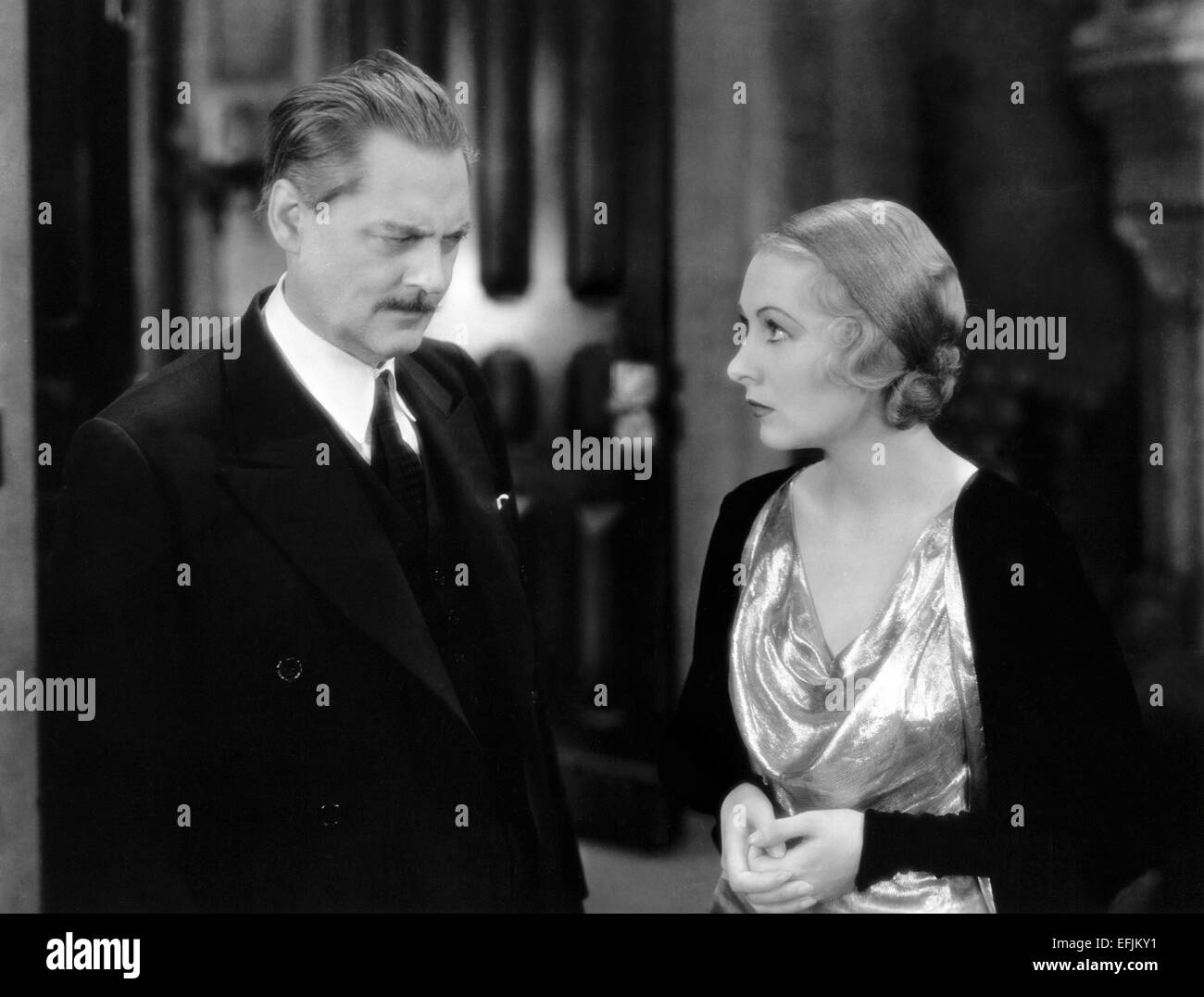 LIONEL BARRYMORE, KAREN MORLEY, ARSENE LUPIN, 1932 Stock Photo