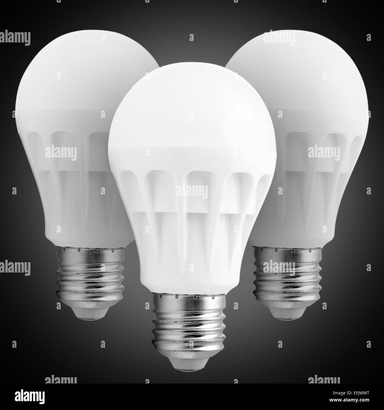 LED lamps with a white flask on a black background. - Stock Image