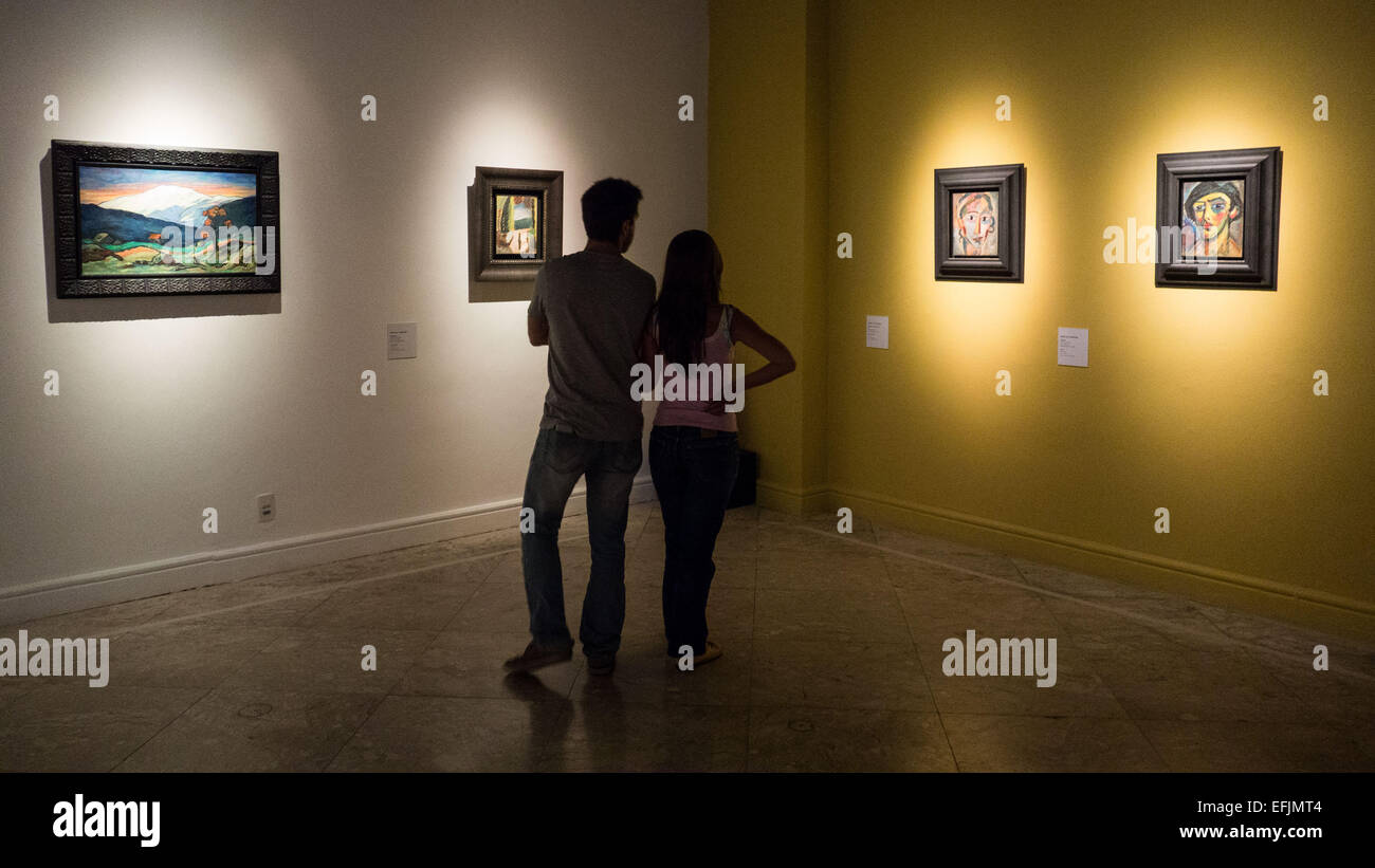 Rio De Janeiro, Brazil. 5th Feb, 2015. Visitors look at the exhibited paintings by Wassily Kandinsky in Rio de Janeiro, - Stock Image