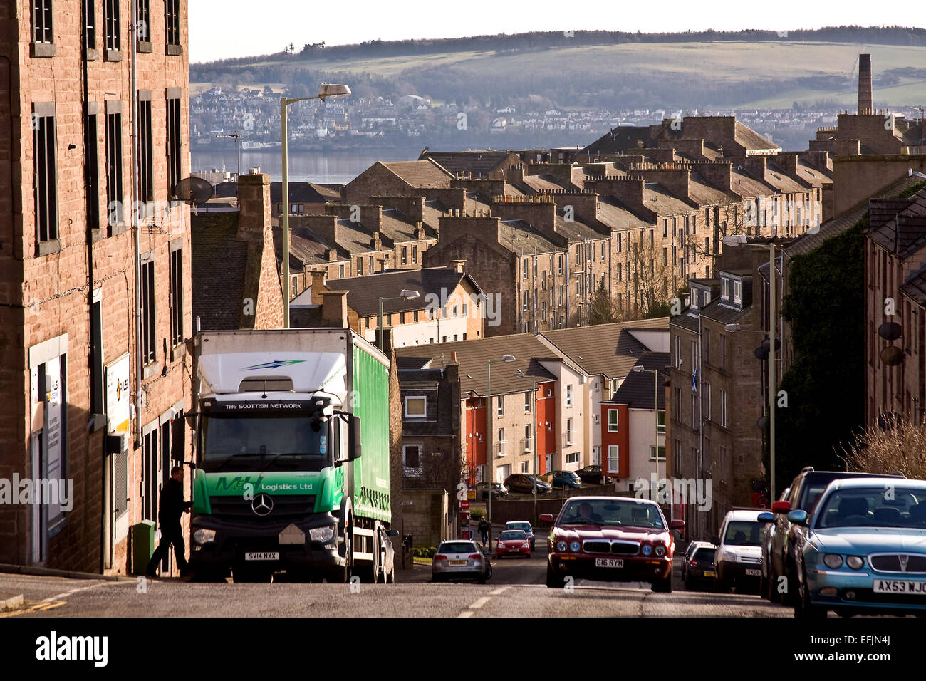 View of old 1800`s Tenement housing from City Road Dundee, UK - Stock Image