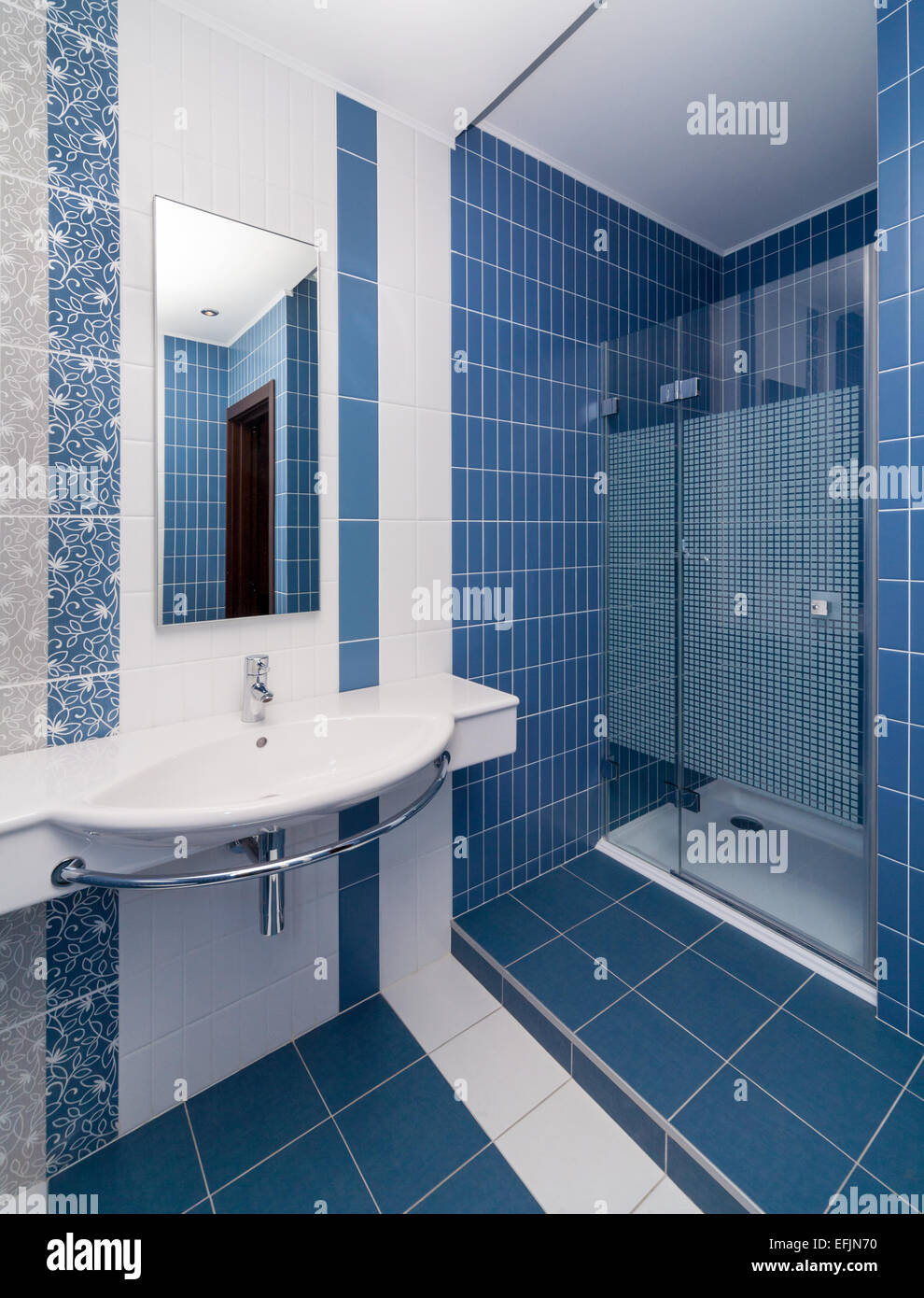 Modern bathroom toled with white and blue tiles Stock Photo ...