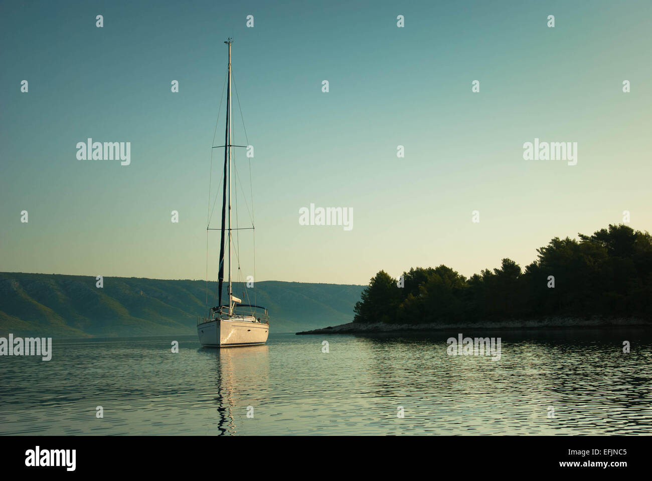 Sailing yacht anchored in a bay Stock Photo