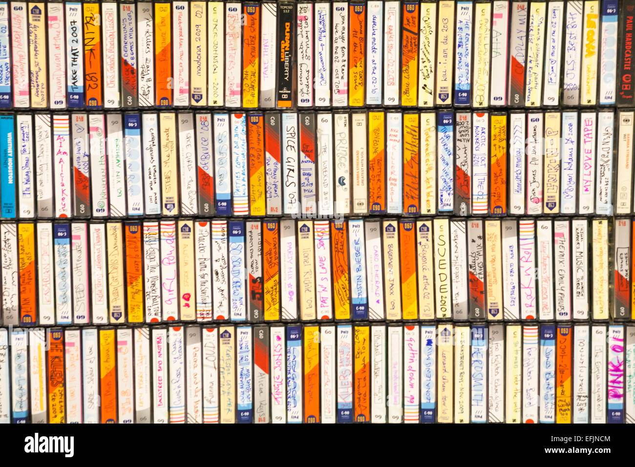 rows of recorded cassette tapes on display at The O2, Peninsula Square, London - Stock Image