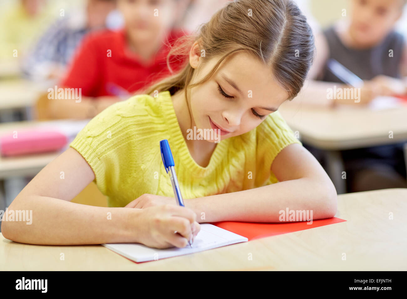 group of school kids writing test in classroom stock photo: 78473601
