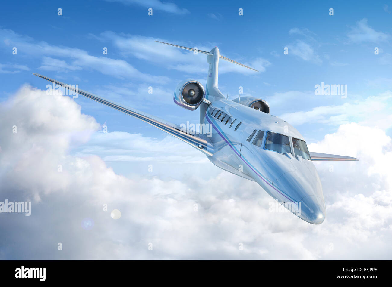 Private Jet airplane flying. Perspective/front view. With sky and clouds background. - Stock Image