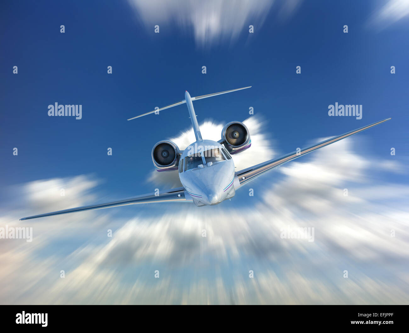 Private Jet airplane flying. Front view, on Sky and clouds background. With speed motion blur effect. - Stock Image