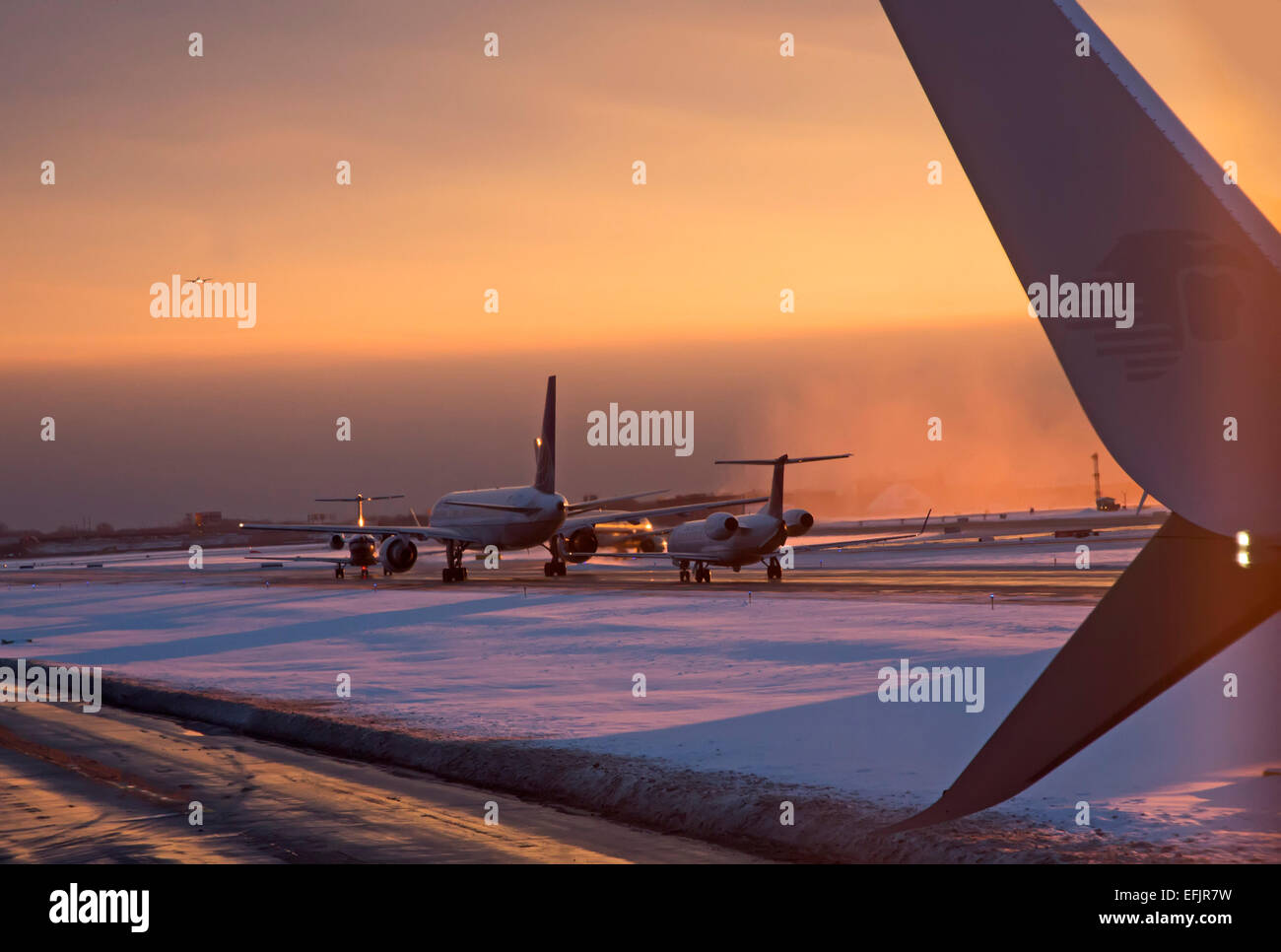Chicago, Illinois - Early morning flights arriving and departing at O'Hare International Airport. - Stock Image