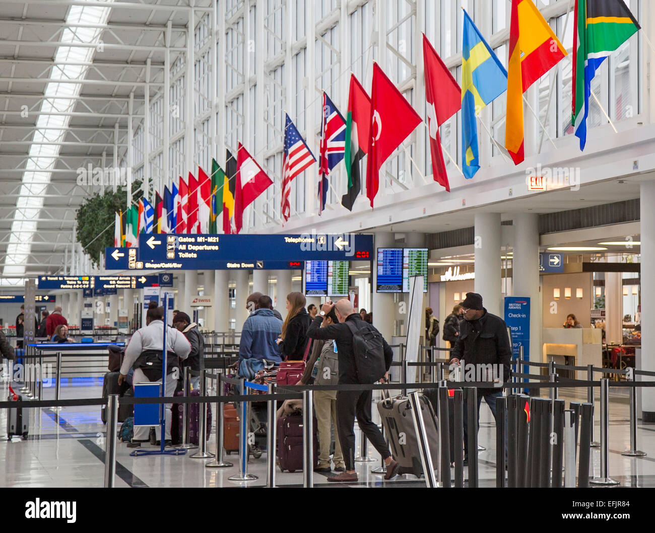 Chicago, Illinois - Passengers waiting in line to check in for flights at O'Hare International Airport's - Stock Image