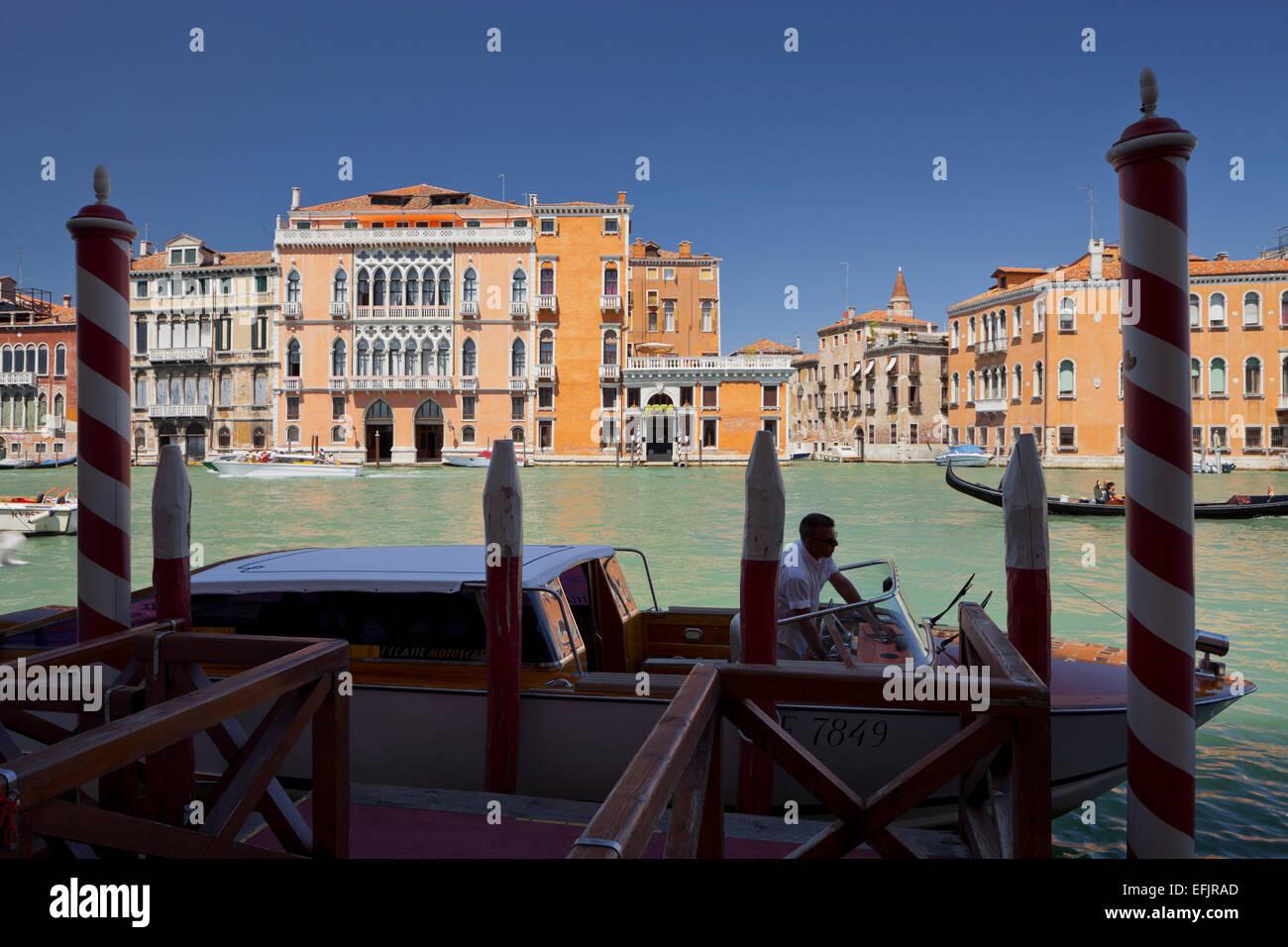 Jetty with boat on the Grand Channel, Palazzo Barbarigo della Stock ...