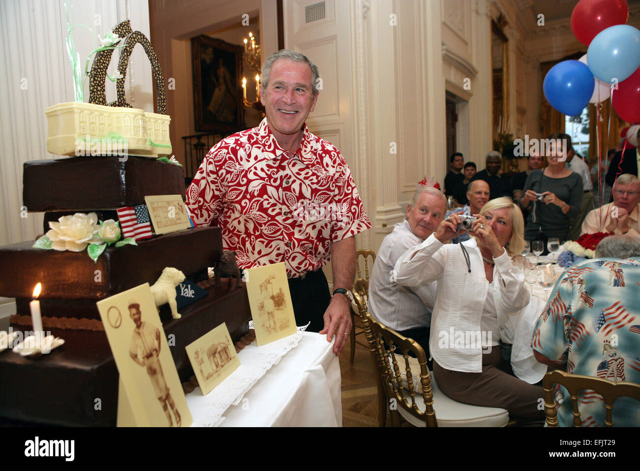 a2e8781ba US President George W. Bush wearing a Hawaiian shirt smiles as he is  presented with a birthday cake during a dinner party at the White House  July 4, ...