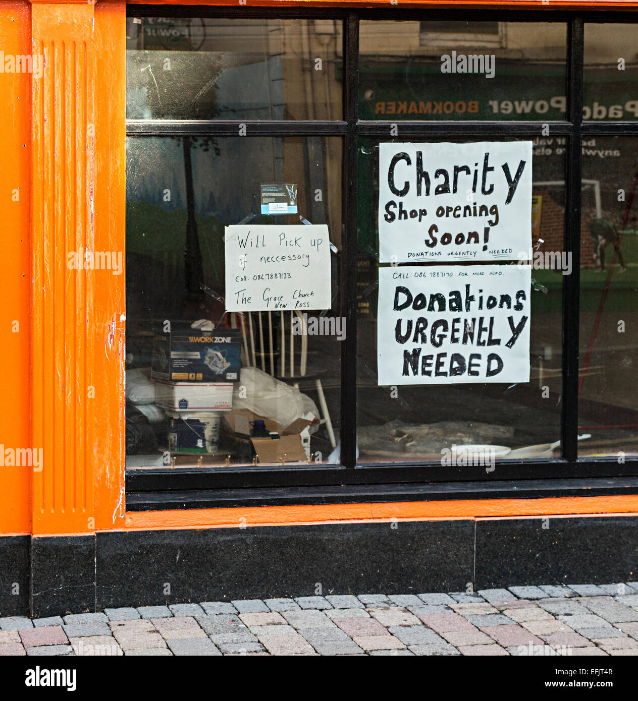 Sign in a charity shop window asking for donations, New Ross, Co. Wexford, Republic of Ireland - Stock Image