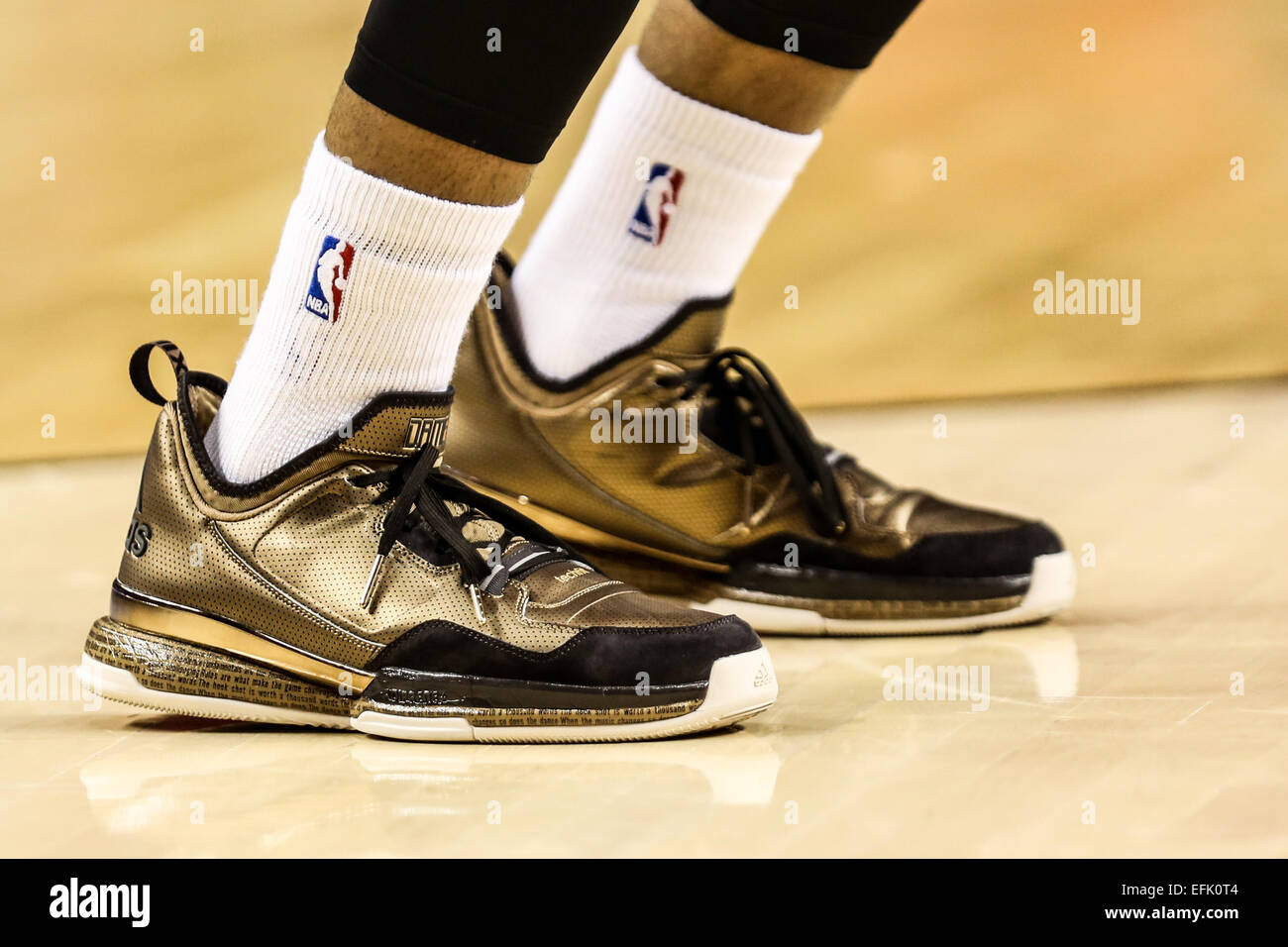 the latest 782b5 dc8c3 DAMIAN LILLARD (0) wears gold Adidas DL1 s. The Portland Trail Blazers play  the Phoenix Suns at the Moda Center on February 5, 2015.