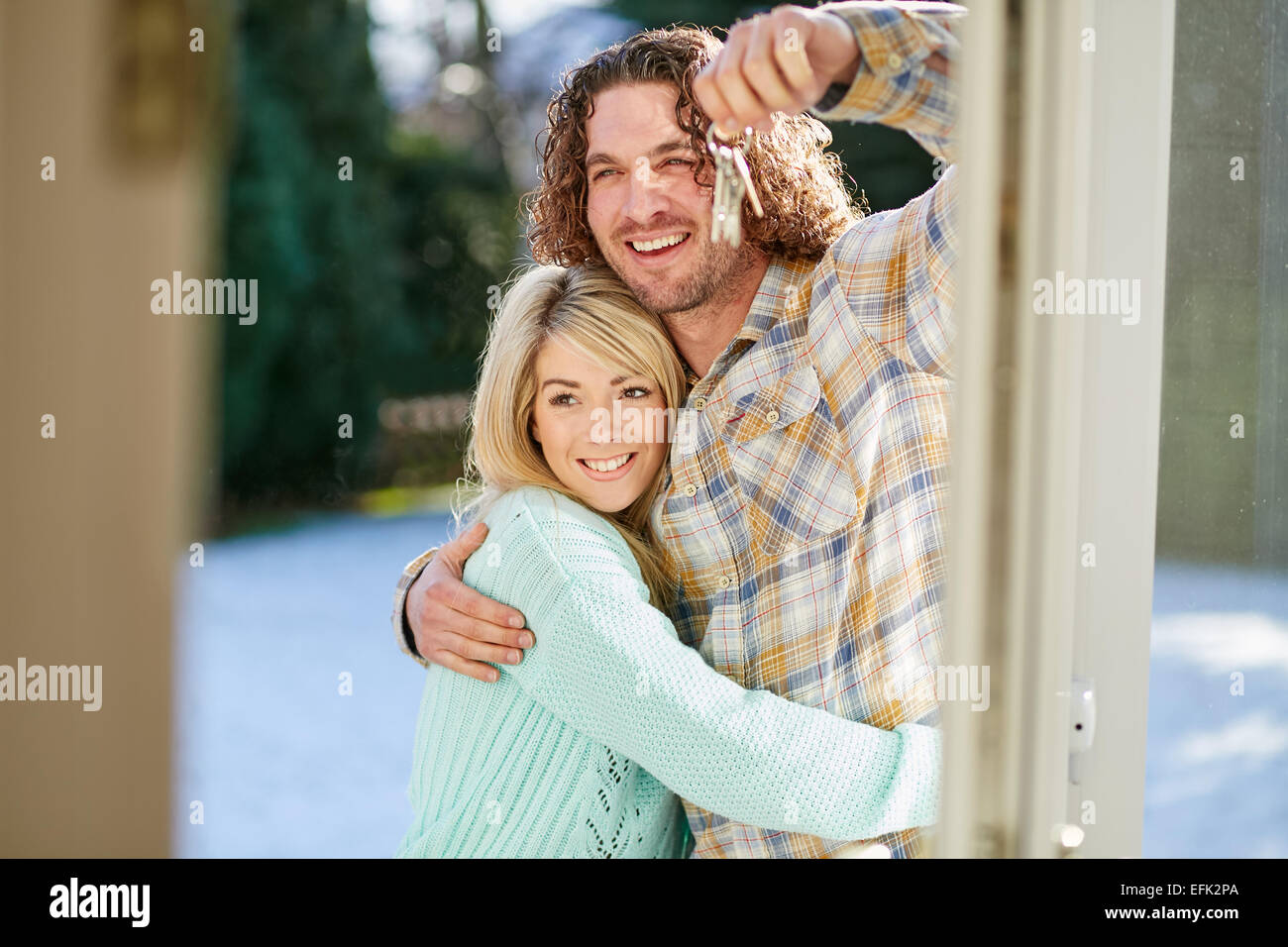 First time buyers holding keys to new house Stock Photo