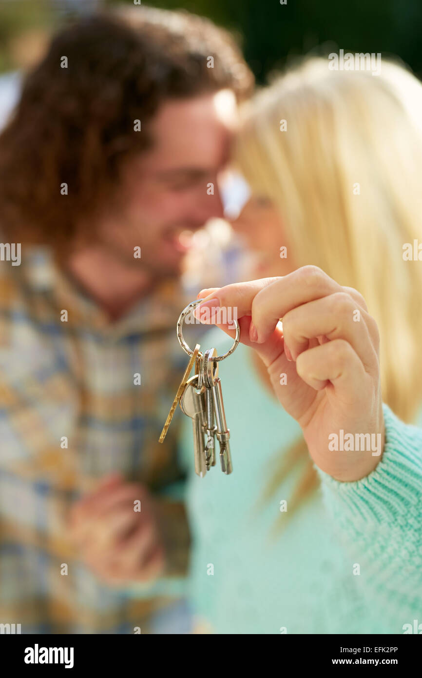 First time buyers holding keys to new house - Stock Image
