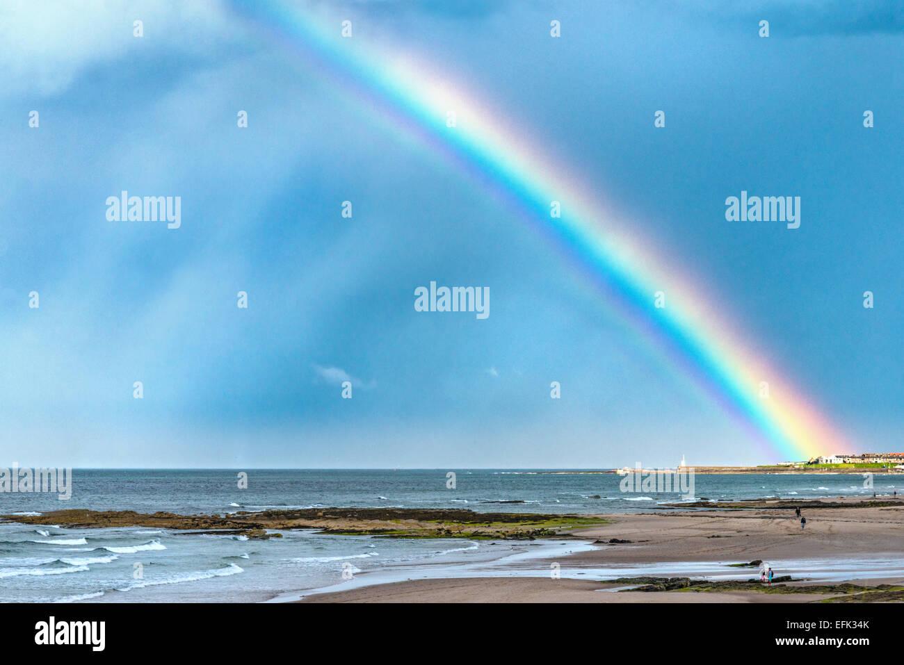 Seahouses Rainbow - Stock Image