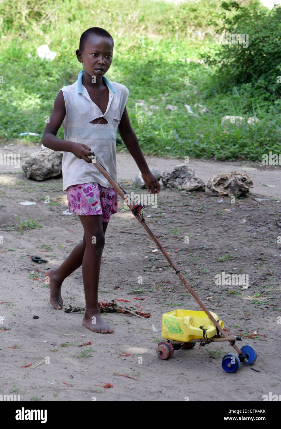 boy with his self-made toy, Kenya, Mombasa, - Stock Image