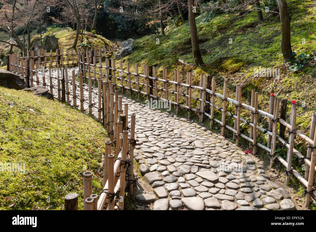 Ritsurin Koen Garden, Takamatsu, Japan. A Path Made From Cobblestones And  Lined With Low Bamboo Fences