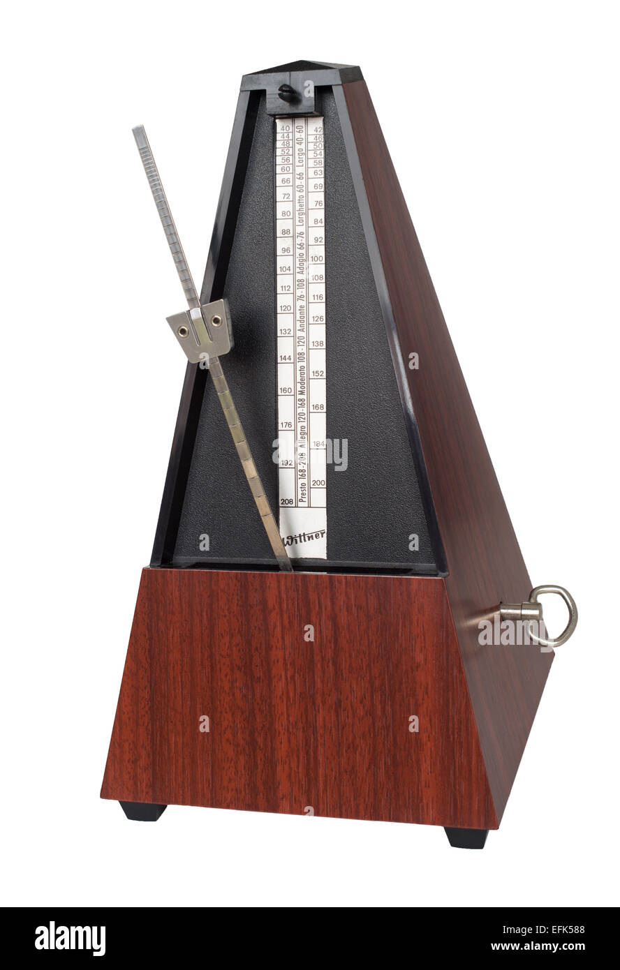 Wittner clockwork traditional metronome isolated on a white background - Stock Image
