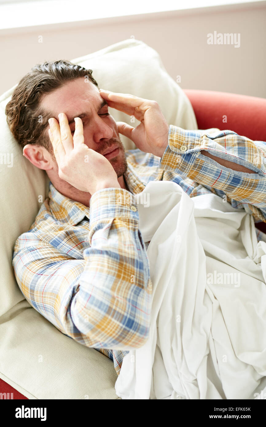 Man laid in bed unwell - Stock Image