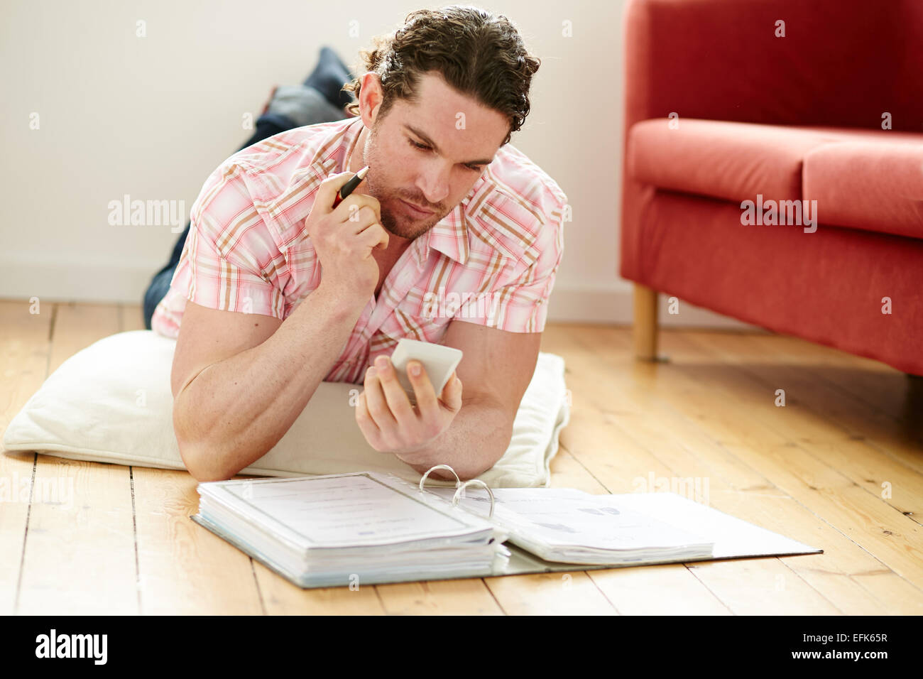 Male working out finances - Stock Image