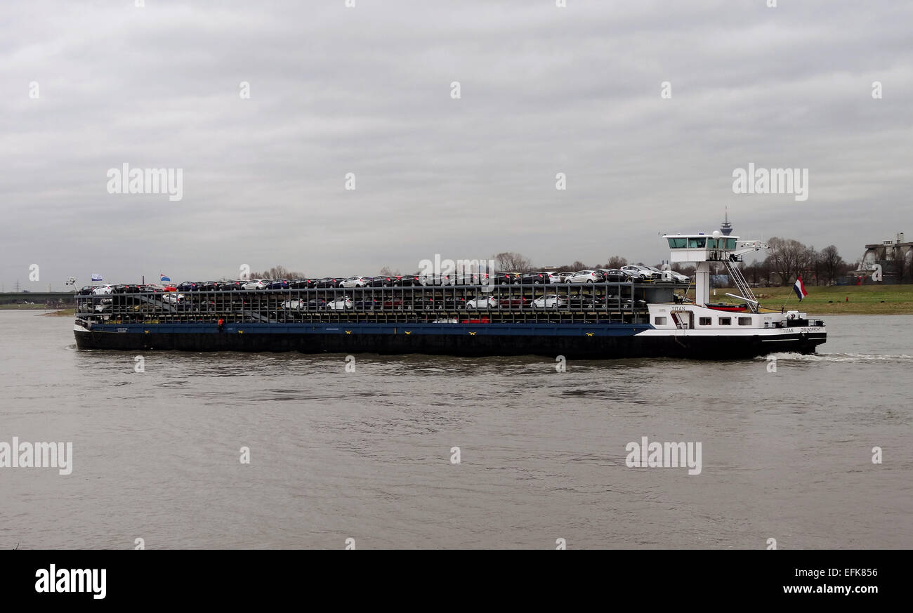 Carcarrier with cars on the River Rhine near Neuss - Stock Image