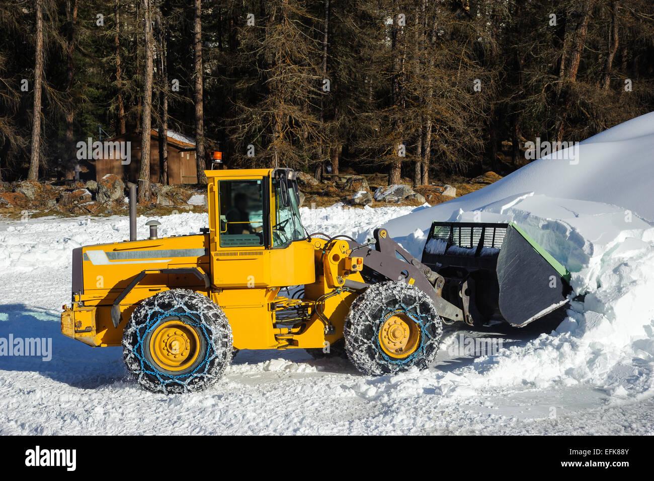 Snow removing with big bulldozer - Stock Image