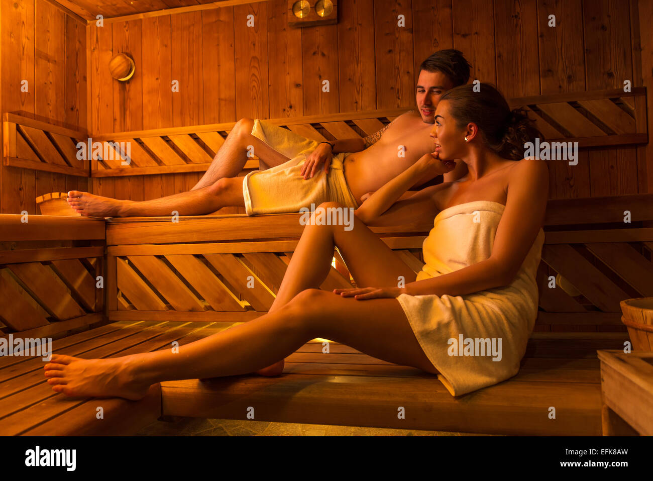 Young couple in sauna - Stock Image