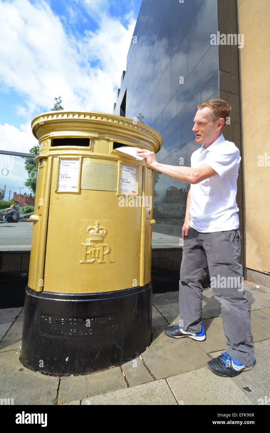 golden post box in the city of Leeds to mark the achievement of Nicola Adams winning two olympic gold medals yorkshire Stock Photo