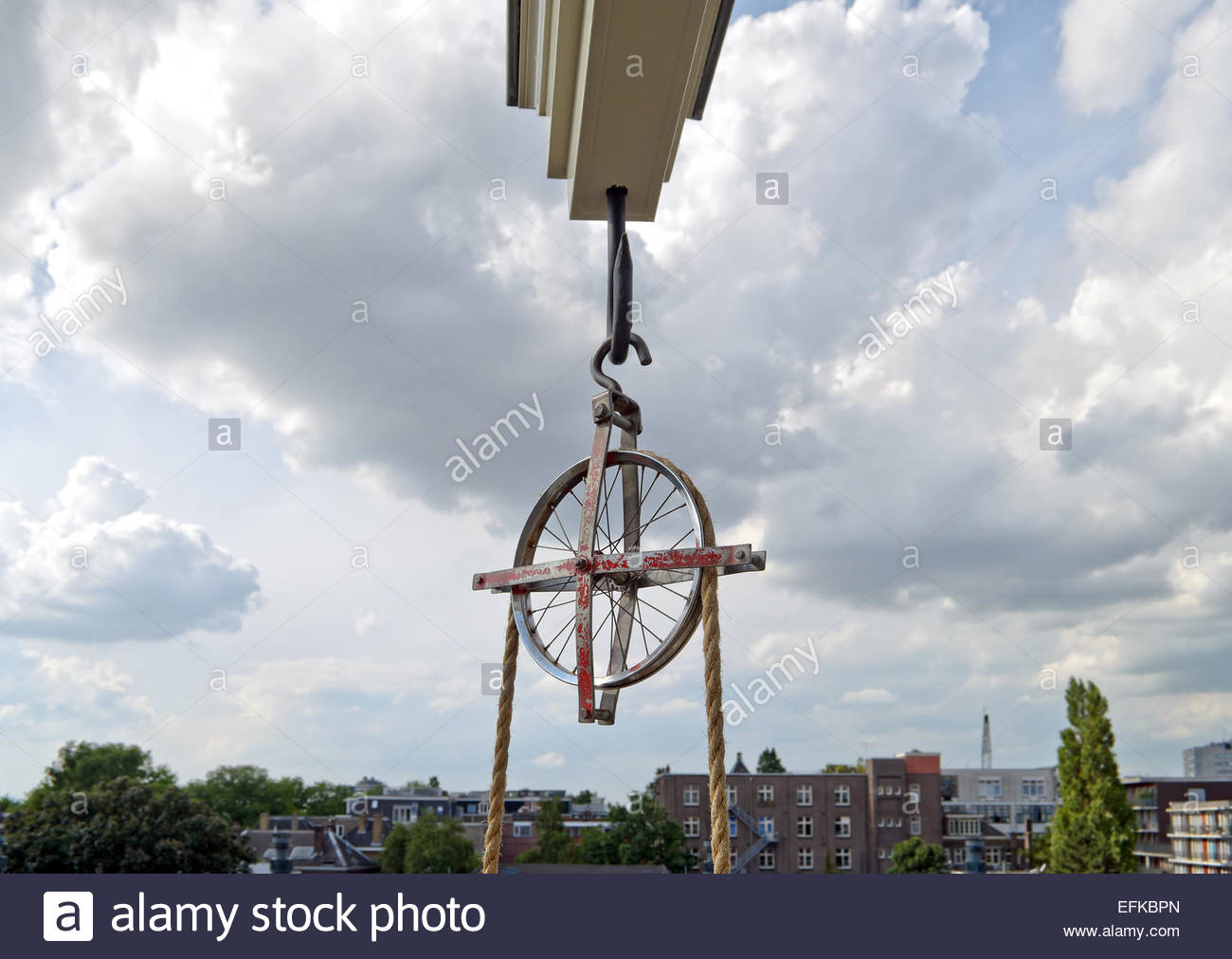 Lifting beam and wheel for moving furniture into or out of a tall house in Amsterdam. - Stock Image