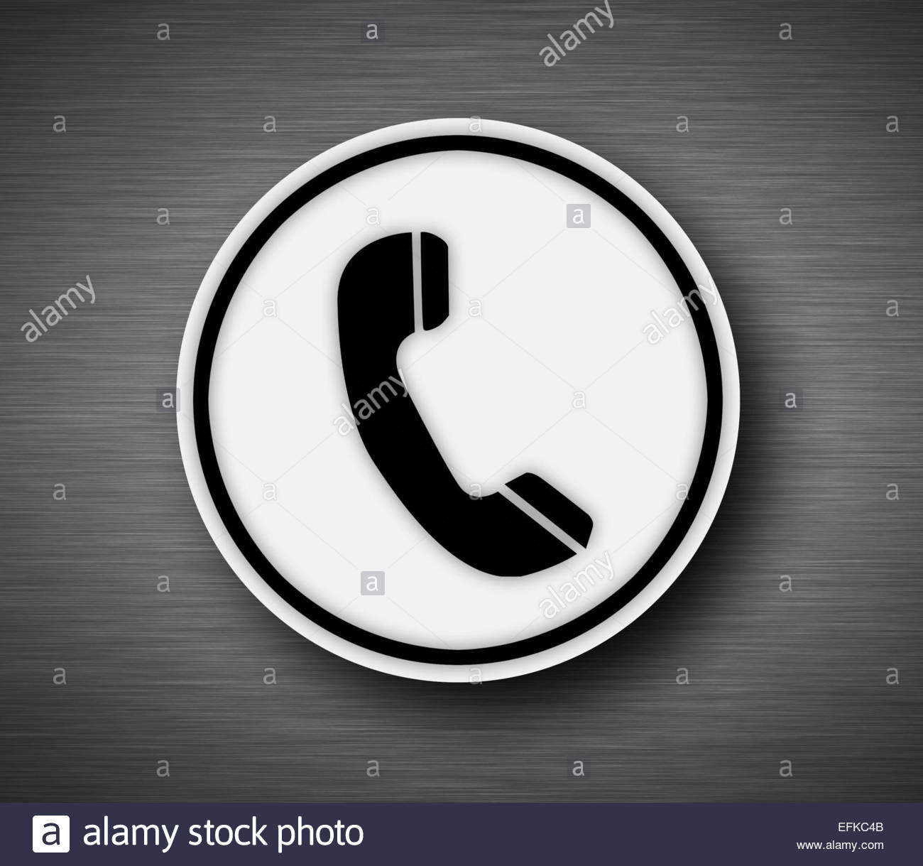 Phone icon on metallic background - Stock Image