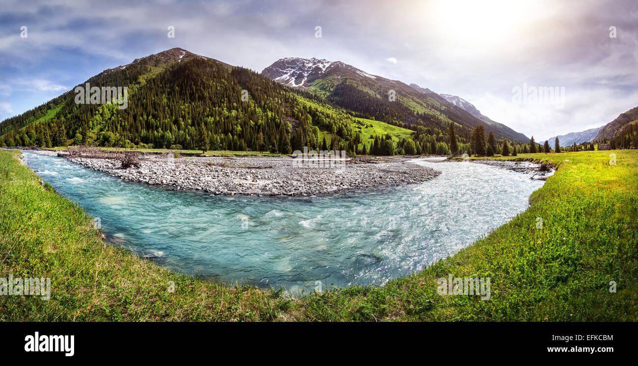 Mountain river panorama in the valley with green grass in Dzungarian Alatau, Kazakhstan, Central Asia - Stock Image