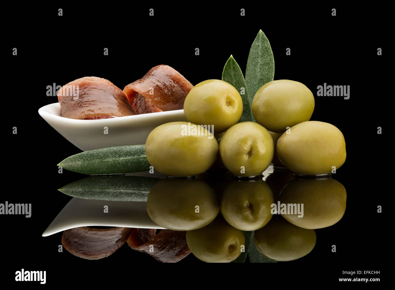 Pickled green olives stuffed with anchovies - Stock Image