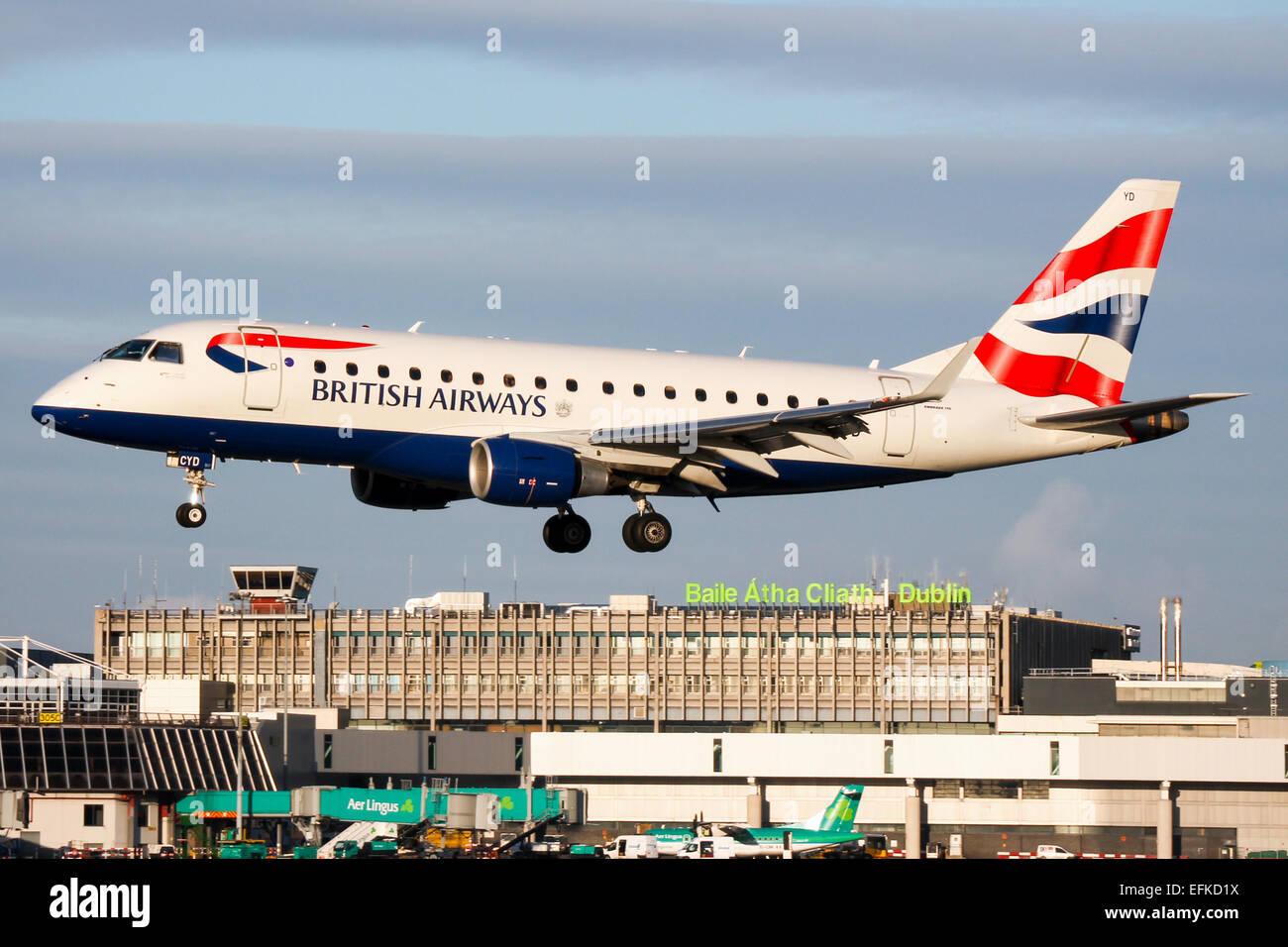 British Airways Embraer 170 approaches runway 28 at Dublin airport. - Stock Image